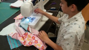 A student sewing for FUN!